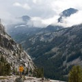 A backpacker enjoys a respite from the storm above the Fall Creek Valley.- Fall Creek - Surprise Valley, Broad Canyon Divide