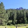 Sierra Buttes (8,591') rises above Herrington's Sierra Pines Resort.- Herrington's Sierra Pines Resort