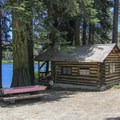 Quaint lakeside cabins are available at Packer Lake Lodge.- Packer Lake Lodge