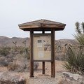 An informational kiosk stands near the trails that leave from Ryan Campground.- Ryan Campground