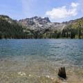 Sardine Lake Resort is located on the banks of Lower Sardine Lake below Sierra Buttes (8,587').- Sardine Lake Resort