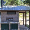 Vault toilets at Sardine Lake Camground.- Sardine Lake Campground