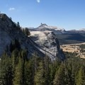 The expanse of Tuolumne Meadows lies below.- Lembert Dome Loop