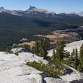 Tuolumne Meadows, Unicorn peak, Cockscomb Peak and Cathedral Peak from the summit of Lembert Dome.- Lembert Dome Loop