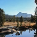 Tuolumne River near Sodas Springs with Unicorn Peak (10,823'), left, and Cathedral Peak (10,912'), right, in view.- Soda Springs