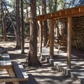 A porch and a picnic table to enjoy the fresh air.- Mono Hot Springs Resort