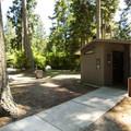 Vault toilet facility at Salt Creek Recreation Area Campground.- Salt Creek Recreation Area Campground