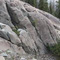 Evidence of glacial activiy can be recognized by the glacially polished slabs along the hike.- North Fork of the Big Wood