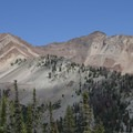 The beautiful south ridge of Peak 10,886 is crossed by several colorful intrusive dikes.- North Fork of the Big Wood