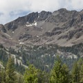 Looking into the headwaters of the North Fork to the divide (low saddle left) with the West Fork of the North Fork drainage. Peak 11,298 is the peak in the middle of the skyline.- North Fork of the Big Wood