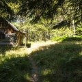 Michael's Cabin along the Elwha River Trail.- Elwha River Trail, Goblin Gates + Humes Ranch Loop