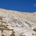 Looking up toward Sawtooth Pass (11,630').- Columbine Lake
