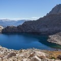 View of Columbine Lake after dropping over Sawtooth Pass.- Columbine Lake