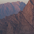 Smoke-filtered alpenglow on the east face of Altair Peak.- Bellas Lakes