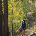 Colorful aspens highlight the descent to the car.- Bellas Lakes