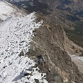 Walking the snow line on the north ridge of the Devil's Bedstead.- The Devils Bedstead via Boulder Lake Canyon