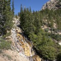 Slab falls cascading from the lip of the upper alpine basin.- Hyndman Creek + Hyndman Basin Hike