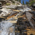 After about 3 miles, the trail climbs up steep steps over 1,200 feet to access the upper glaciated basin. The trail passes by this playful slab falls that cascades over sedimentary quarzite for the final climb into the upper basin.- Hyndman Creek + Hyndman Basin Hike