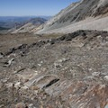 Different layers of exposed rock include a metamorphosed gneiss.- Hyndman Creek + Hyndman Basin Hike