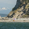 View of Point Wilson Lighthouse, Three Fingers South (6,850 ft), and Artillery Hill from North Beach.- North Beach, Port Townsend