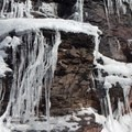 Water frozen in time clings to the rocks on the side of Rim Road.- The Watchman Snowshoe