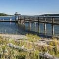 Boat dock and fishing pier at Fort Flagler State Park.- Fort Flagler State Park