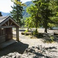 Vault toilet facility at Bear Gulch Day Use Area.- Lake Cushman, Bear Gulch Day Use Area