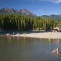 Skokomish Park Beach and enclosed swimming area with view of Mount Ellinor (5,940') and Mount Washington (6,255') to the north.- Lake Cushman, Skokomish Park Beach + Day Use Area