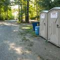 Vault toilet facility at Lake Cushman Resort + Campground.- Lake Cushman Resort + Campground