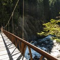 Suspension bridge crossing over the Elwha River en route to Dodge Point.- Olympic National Park