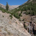 The grueling West Pass Trail climbs up the left side of the drainange past a few waterfalls in West Pass Creek.- North Fork of the Big Wood - West Pass