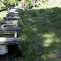 An old sheep watering trough in a hanging meadow two-thirds of the way up the trail.- Driveway Gulch Hike