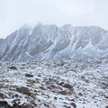 A lone tent in a wintry landscape near Bishop Pass.- South Lake, Bishop Pass Trail