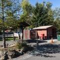 Vault toilet facility at Rocky Point Campground.- Alder Lake, Rocky Point Campground