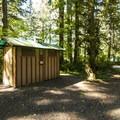 Vault toilet facilities at Big Creek Campground.- Big Creek Campground