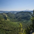 View southeast along the trail toward Goat Rocks (8,184') and Mount Adams (12,281').- High Rock Lookout Tower Hike