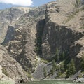 A paddle boat enjoys the scenic vistas that abound in the lower canyon.- Middle Fork of the Salmon River - Overview