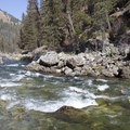 A kayaker enjoys the low water waves through Hell's Half Mile.- Middle Fork of the Salmon River - Day 1