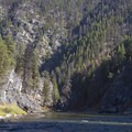 Heavy timber flanks the river above the Chutes Rapid.- Middle Fork of the Salmon River - Day 1
