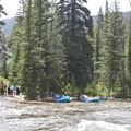 High water (7 feet) will begin to flood out many camps. Here a group of private boaters takes a break at Big Bend Camp.- Middle Fork of the Salmon River - Day 1