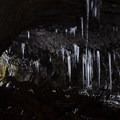 Illuminated stalactites in Guler Ice Caves.- Guler Ice Caves