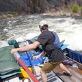 Passing the Artillery Ledge hole in the commercial sweep boat.- Middle Fork of the Salmon River - Day 2