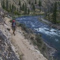 A hiker cruises the trail above Aparajo Rapid.- Middle Fork of the Salmon River - Day 4