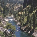 Several boats jocky for position and access to the popular Veil Cave waterfall hike.- Middle Fork of the Salmon River - Day 5