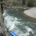 Kayak carnage in Cliffside Rapid. It is fairly easy to avoid the wave train at the base of the cliff wall, but then it wouldn't be any fun!- Middle Fork of the Salmon River - Day 5