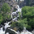 A raging waterfall creek adds even more flow to the Middle Fork in early June.- Middle Fork of the Salmon River - Day 5