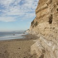 Sheer cliff-faces are the backdrop for this spectacular beach.- Mesa Lane