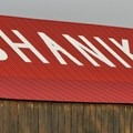 A prominent barn bears the town's name on its roof.- Shaniko
