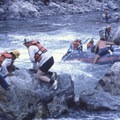 A an old photo (circa 1970) of a boat pulling off a wrap on the large downstream right boulder in Devil's Tooth. Clearly, life jackets would have been a good idea.- Middle Fork of the Salmon River - Day 6
