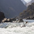 A kayaker dissapears just to the river left of the rock called the Devil's Tooth.- Middle Fork of the Salmon River - Day 6